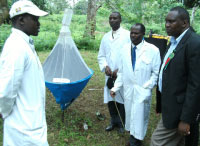 AGRICULTURE: Assistant minister Kareke Mbiuki (R) is shown how to trap tsetse flies at the agriculture stand at this year's Eastern Agricultural show in Embu